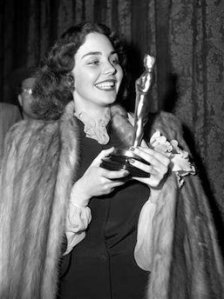 "Handout photo shows actress Jones holding her Academy Award for her titular role in ""The Song of Bernadette"" during the awards ceremony in Hollywood"